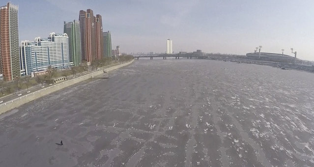 This image made from Associated Press Television News video shows an aerial view of the frozen Taedong River in Pyongyang, North Korea, on Wednesday, January 20, 2015. The depths of winter have hit North Korea, with temperatures dropping lower than last year. (Photo by Associated Press Television News via AP Photo)