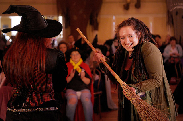 The new witch of Wookey Hole Caves Anna Dixon from Glastonbury receives her broom following auditions held at the Somerset tourist attraction, on October 22, 2013. Around 50 applicants took part in the auditions today for a £50,000 a year (pro rata) job as the face of Wookey Hole. (Photo by Tim Ireland/PA Wire)