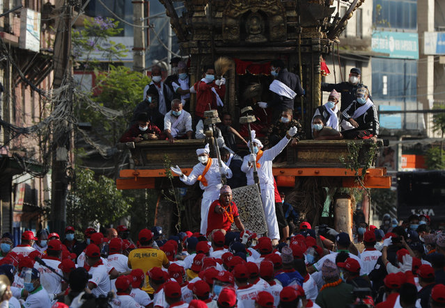 Nepalese devotees pull a chariot during the Rato Machindranath chariot festival in Lalitpur, Nepal, Saturday, May 15, 2021. (Photo by Niranjan Shrestha/AP Photo)