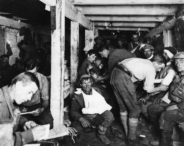 British tommies relaxing and having wounds treated in an underground forward dressing station by the Menin Road in France, 1914. (Photo by Frank Hurley/Three Lions/Getty Images)