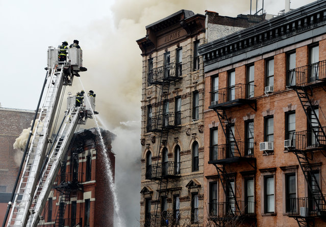 Firefighters work to extinguish a fire in a building that collapsed in New York City, March 26, 2015. (Photo by Justin Lane/EPA)