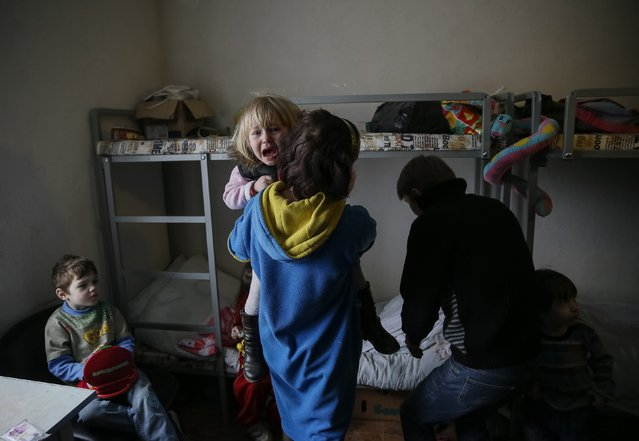 Refugees, who left their homes because of the fighting in eastern Ukraine, are seen in a volunteer centre in Slaviansk March 12, 2015. (Photo by Gleb Garanich/Reuters)