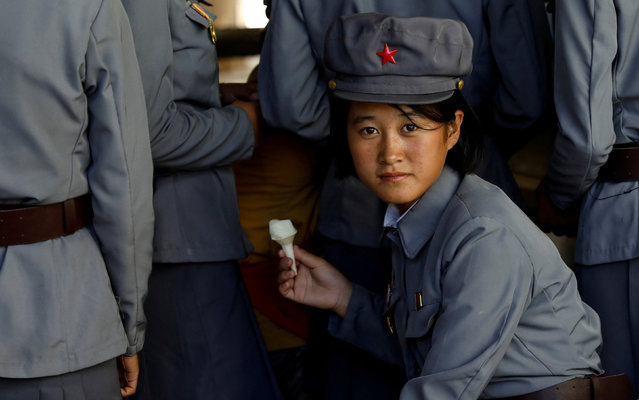 A soldier eats ice cream as she visits a zoo in Pyongyang, North Korea, September 12, 2018. (Photo by Danish Siddiqui/Reuters)
