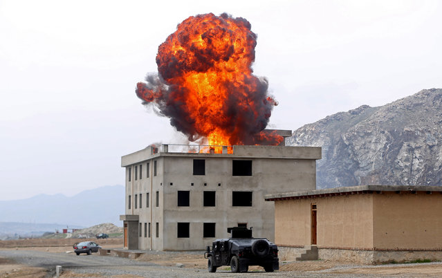 Smoke rises after an explosion during a military exercise in Kabul, Afghanistan, Thursday, April 2, 2015. (Photo by Massoud Hossaini/AP Photo)