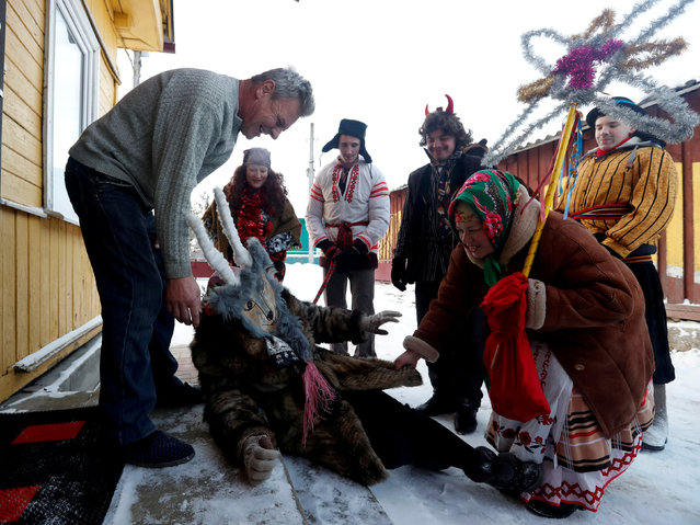 """People celebrate the pagan rite called """"Kolyadki"""", a pagan winter holiday which over the centuries has merged with Orthodox Christmas celebrations in some parts of Belarus, in the village of Abadoutsy, Belarus January 7, 2019. (Photo by Vasily Fedosenko/Reuters)"""