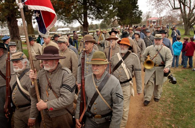 Period-costumed actors participate in the 150th anniversary re-enactment of the surrender of General Robert E. Lee to General Ulysses S. Grant at the Museum of Confederacy in Appomattox, Virginia,  April 9, 2015. (Photo by Jay Paul/Reuters)