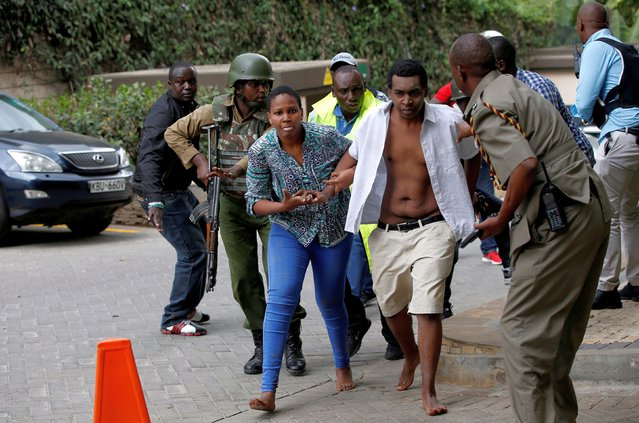 People are evacuated at the scene where explosions and gunshots were heard at the Dusit hotel compound, in Nairobi, Kenya January 15, 2019. (Photo by Thomas Mukoya/Reuters)