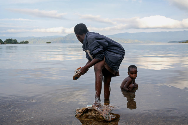 Bahavu children wash on the shore of Lake Kivu, on Idjwi island, in the Democratic Republic of Congo, November 22, 2016. (Photo by Therese Di Campo/Reuters)