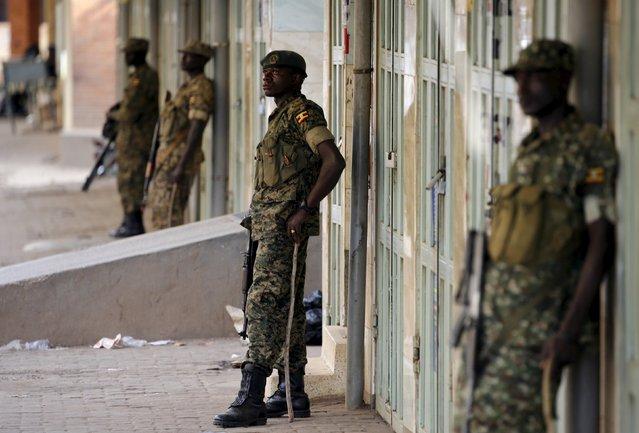 Ugandan soldiers stand along a street in Kampala, Uganda February 20, 2016. (Photo by Goran Tomasevic/Reuters)
