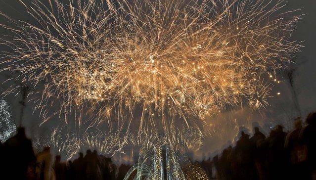 Fireworks light up the sky during New Year's celebrations in Bucharest, Romania. (Photo by Vadim Ghirda/Associated Press)