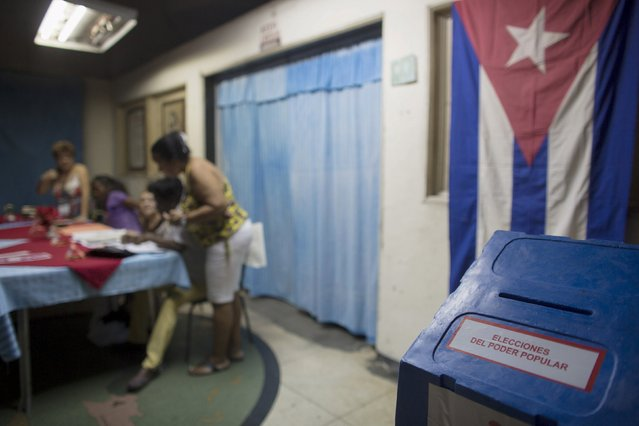 Election officials work at a polling station in Havana April 19, 2015. (Photo by Alexandre Meneghini/Reuters)