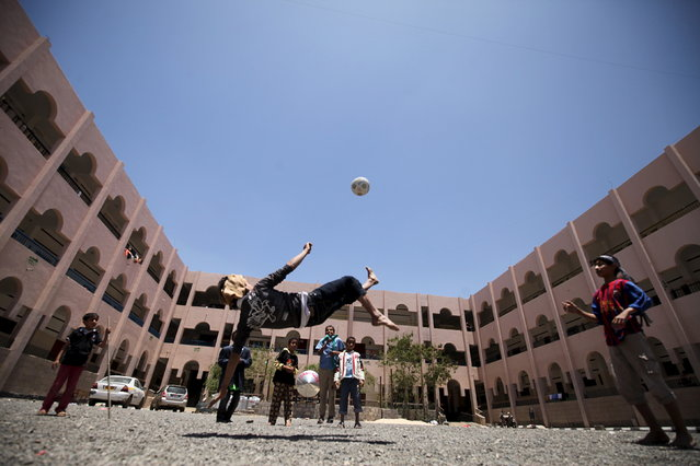 Internally displaced people play football in a school in Sanaa, Yemen May 17, 2015. (Photo by Mohamed al-Sayaghi/Reuters)