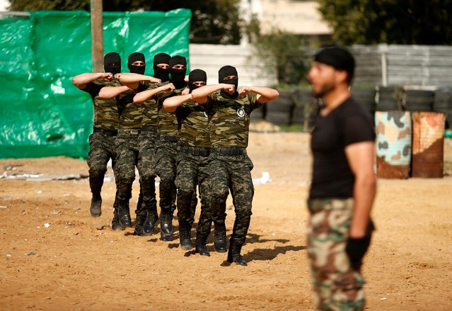 Members of Palestinian National Security Forces loyal to Hamas march in formation during a military graduation ceremony, in Gaza City January 22, 2017. (Photo by Suhaib Salem/Reuters)