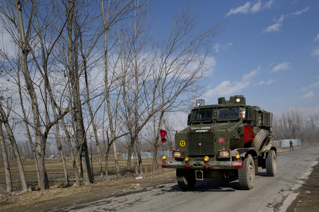 An Indian army armored vehicle rushes towards the site of a gun battle in Pulwama, south of Srinagar, Indian controlled Kashmir, Monday, February 18, 2019. Tensions continued to rise in the aftermath of a suicide attack in disputed Kashmir, with seven people killed Monday in a gunbattle that broke out as Indian soldiers scoured the area for militants. (Photo by Dar Yasin/AP Photo)