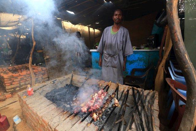 A man prepares food at Abo-Shouk IDPs camp at Al Fashir in North Darfur, Sudan February 17, 2016. (Photo by Mohamed Nureldin Abdallah/Reuters)