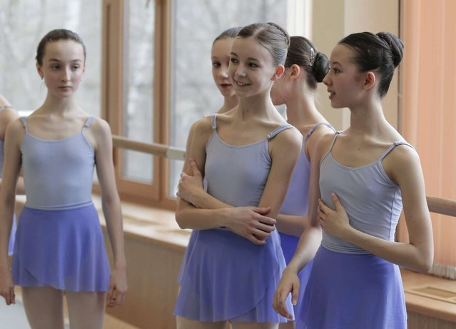 Students take part in a class at the Moscow State Academy of Choreography in Moscow, on March 3, 2016. (Photo by Yuri Kochetkov/EPA)
