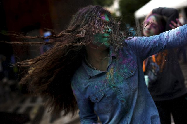 A young woman throws coloured powder during Holi festival in Madrid April 26, 2015. (Photo by Susana Vera/Reuters)