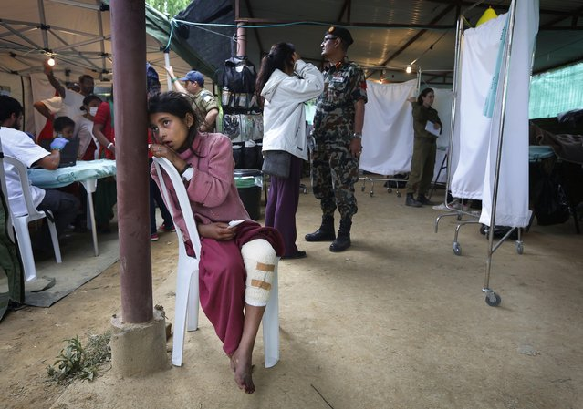 An Earthquake-affected Nepalese girl waits for treatment after receiving local first-aid elsewhere, at the Israeli field hospital for earthquake victims in Kathmandu, Nepal, Wednesday, April 29, 2015. Saturday's disaster killed thousands and also injured many more, police said. The U.N. says the disaster has affected 8.1 million people, more than a fourth of Nepal's population of 27.8 million, and that 1.4 million needed food assistance. (Photo by Manish Swarup/AP Photo)