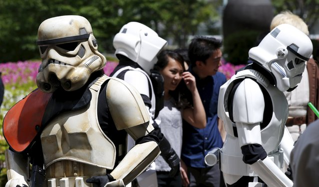 Cosplayers dressed up as Star Wars characters Storm Troopers and Scout Trooper (C) take part in a Star Wars Day fan event in Tokyo May 4, 2015. (Photo by Toru Hanai/Reuters)