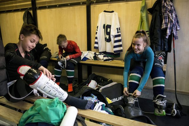 Under 14 ice hockey team of Central Sports School Budapest (KSI) captain Orsolya Soled (R) and her team mates change in the dressing room before a training session played against FTC of Budapest in FTC's ice rink in Budapest, Hungary, 04 March 2016. (Photo by Bea Kallos/EPA)