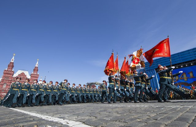 Russian army soldiers march along the Red Square during a general rehearsal for the Victory Day military parade which will take place at Moscow's Red Square on May 9 to celebrate 70 years after the victory in WWII, in Moscow, Russia, Thursday, May 7, 2015. (Photo by Alexander Zemlianichenko/AP Photo)