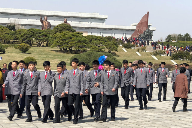 People attend celebrations of Day of the Sun on Mansudae (Mansu) Hill by bronze statues of North Korean leaders Kim Il-sung and Kim Jong-il in Pyongyang, North Korea on April 14, 2019. Day of the Sun is an annual public holiday celebrated on April 15, the birth anniversary of Kim Il-sung, the founder of North Korea. (Photo by Yevgeny Agoshkov/TASS)