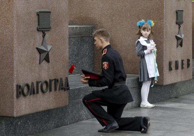 "A Ukrainian cadet lays flowers at the Museum of Great Patriotic War during a patriotic forum ""Two Generations – Two Wars"" in Kiev, Ukraine May 5, 2015. (Photo by Valentyn Ogirenko/Reuters)"