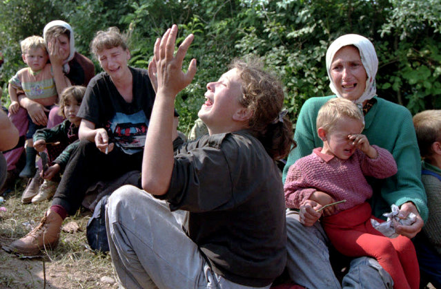 Bosnian refugees from Srebrenica wail over their missing men in the refugee camp at the Tuzla airport, July 1995. (Photo by Reuters)