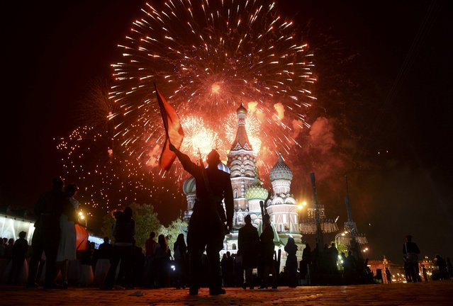 Fireworks explodes over Red Square, with St. Basil's Cathedral seen on the background, during the Victory Day celebrations in Moscow, Russia, May 9, 2015. (Photo by Reuters/Host Photo Agency/RIA Novosti)