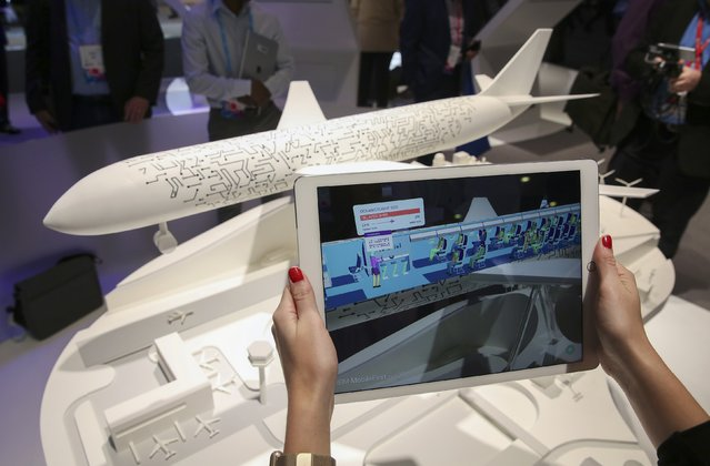 The IBM MobileFirst, for iOS app for use by airline industry personnel, is displayed at the IBM stand at the Mobile World Congress in Barcelona, Spain, March 1, 2017. (Photo by Paul Hanna/Reuters)