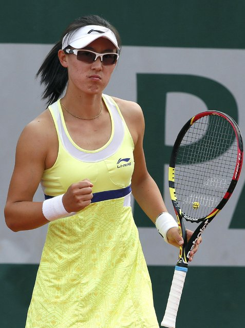 Saisai Zheng of China reacts during the women's singles match against Lucie Hradecka of the Czech Republic at the French Open tennis tournament at the Roland Garros stadium in Paris, France, May 25, 2015. (Photo by Gonzalo Fuentes/Reuters)
