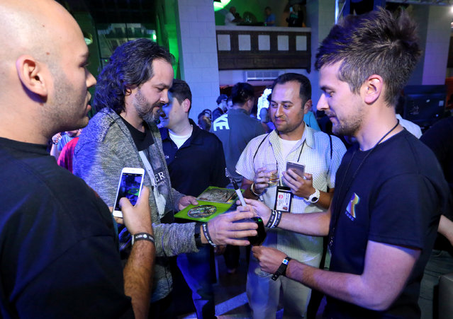 IMAGE DISTRIBUTED FOR MICROSOFT -Kudo Tsunoda, Corporate Vice President, Microsoft Studios, interacts with gamers at the Xbox Media Showcase at E3 in Los Angeles on Monday, June 15, 2015. (Photo by Casey Rodgers/Invision for Microsoft/AP Images)