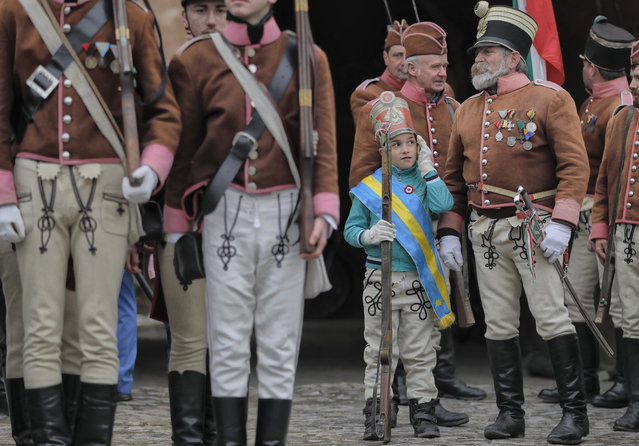 Ethnic Hungarians wearing Hussar uniforms take part in a parade in Targu Secuiesc, Romania, Wednesday, March 15, 2017. (Photo by Vadim Ghirda/AP Photo)