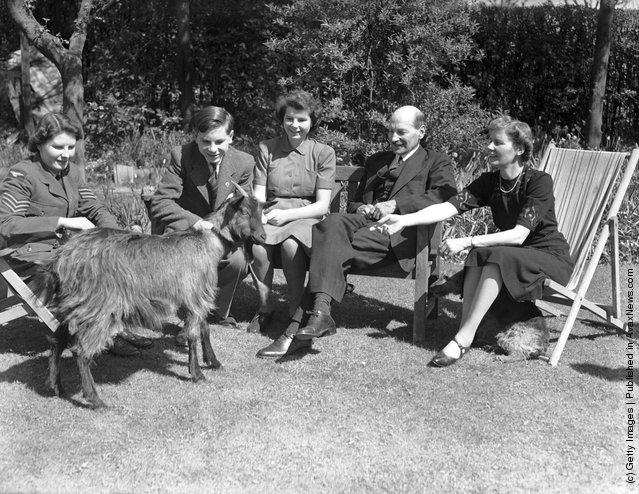 British Deputy Prime Minister Clement Attlee (1883 - 1967) with his wife, three of their children and their pet goat Mary, in the garden at their home in Stanmore, Middlesex, April 1943. Left to right: Janet Attlee, Martin Attlee (1927 - 1991), Felicity Attlee (1925 - 2007), Clement Attlee and his wife Violet (1885 - 1964)