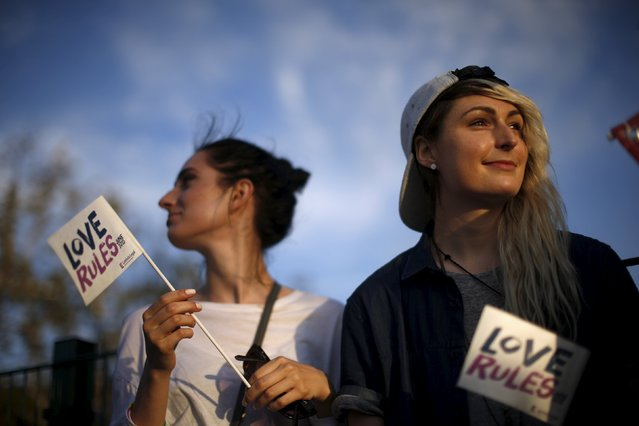 Sisters Alexa Senfelds, 19, (L) and Allie Senfelds, 25, attend a LGBT celebration rally in West Hollywood, California, United States, June 26, 2015. (Photo by Lucy Nicholson/Reuters)