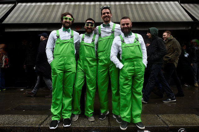 People dressed in green outfits pose for a picture during the St. Patrick's day parade in Dublin, Ireland on March 17, 2017. (Photo by Clodagh Kilcoyne/Reuters)