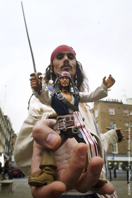 A Jack Sparrow look-a-like poses with a toy version of the Pirates of Caribbean character, at the Dream Toys 2006