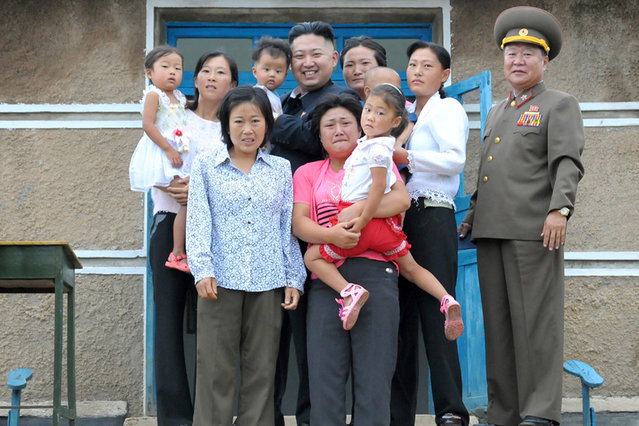 North Korean leader Kim Jong-Un (top C) poses with residents as he visits a military unit on an island in the most southwest of Pyongyang in this picture released by the North's official KCNA news agency in Pyongyang August 19, 2012. KCNA did not state precisely when the picture was taken. (Photo by Reuters/KCNA)