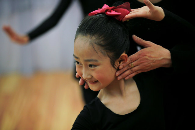 A teacher gives instructions to a student practicing dance at the Mangyongdae Children's Palace in Pyongyang, North Korea May 5, 2016. (Photo by Damir Sagolj/Reuters)