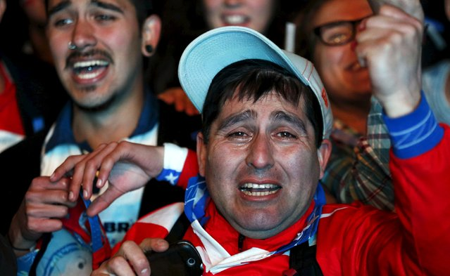 Chilean soccer fans react after winning the Copa America 2015 final soccer match between Chile and Argentina at a fan fest in Santiago, Chile, July 4, 2015. (Photo by Mariana Bazo/Reuters)