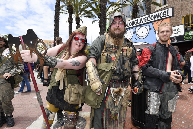 Costumed characters work the crowds on Fifth Avenue outside the convention center on the second day of the 2015 Comic-Con International held at the San Diego Convention Center Friday, July 10, 2015, in San Diego.  (Photo by Denis Poroy/Invision/AP Photo)