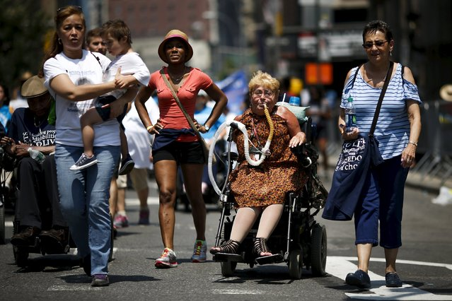 Nancy Brown (C), 73, who suffers from polio since she was 7-years-old, takes part in the disability pride parade in New York, July 12, 2015. (Photo by Eduardo Munoz/Reuters)