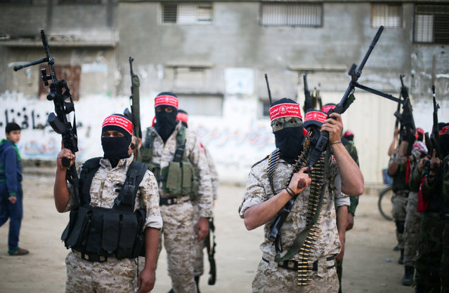 Palestinian militants of the Democratic Front for the Liberation of Palestine (DFLP) take part in a military show in Rafah in the southern Gaza Strip February 28, 2017. (Photo by Ibraheem Abu Mustafa/Reuters)