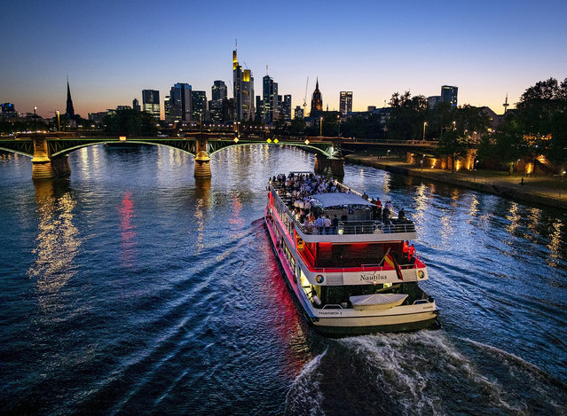 A party ship cruises over the river Main in Frankfurt, Germany, late Thursday, June 27, 2019. (Photo by Michael Probst/AP Photo)