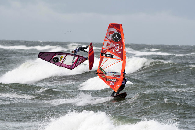 Daniel Bruch (R) and Miguel Chapuis (L) in action on the beach of Westerland, Sylt island, northern Germany, 30 September 2019. The Windsurf World Cup Sylt on Germany's most northern island takes place until 6 October. (Photo by Martin Ziemer/EPA/EFE)