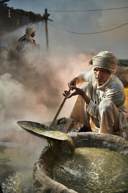 """Melting Pot"". During our adventure through India, we noticed a dramatic cloud of smoke filling the sky from a distance. We stopped to investigate and met a man named Dhruv who responded well to our curiosity and shared with us the filtration process for creating brown sugar. Photo location: Punjab, India. (Photo and caption by Gurminder Banga/National Geographic Photo Contest)"
