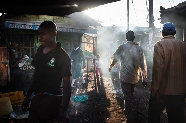The cramped streets of the slum of Kibera where many environmental migrants fleeing from the countryside go to live in Narobi, Kenya. (Photo by Alessandro Grassani)