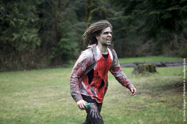 Participants learn how to survive in the wild, including tips on how to make it through a zombie invastion at a Zombie First Responder course in Sandy, Oregon