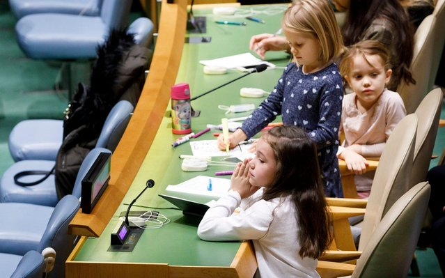 Children sit at a delegate table during an event marking the thirtieth anniversary of the adoption of the Convention on the Rights of the Child on annual Universal Children's Day in General Assembly hall at United Nations headquarters in New York, New York, USA, 20 November 2019. United Nations Goodwill Ambassadors soccer star David Beckham and actor Millie Bobby Brown were among the speakers at the event. (Photo by Justin Lane/EPA/EFE)