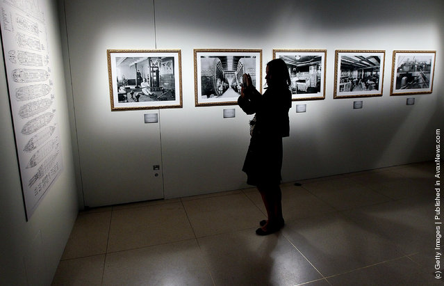 Members of the press view exhibits during a media preview of a new exhibit 'Titanic: 100 Year Obsession', at the National Geographic Museum which highlights the history of the Titanic and its sinking in the year 1912